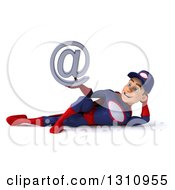 Clipart Of A 3d Young White Male Super Hero Mechanic In A Navy Blue And Red Suit Resting On His Side And Holding An Email Arobase At Symbol Royalty Free Illustration