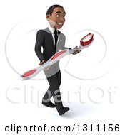 Clipart Of A 3d Happy Young Black Businessman Or Dentist Walking To The Right And Carrying A Giant Toothbrush Royalty Free Illustration