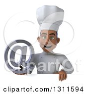 Clipart Of A 3d Young Black Male Chef Holding An Email Arobase At Symbol Over A Sign Royalty Free Illustration