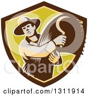 Retro Male Farmer Holding A Scythe And Harvested Wheat In Brown And Green Shield