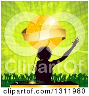 Clipart Of A Silhouetted Female Dj Wearing Headphones Over A Record Deco Under A Gold Disco Ball With Banner Dancing Crowd And Green Burst Royalty Free Vector Illustration by elaineitalia