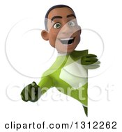 Clipart Of A 3d Young Black Male Super Hero In A Green Suit Pointing Outwards Around A Sign Royalty Free Illustration