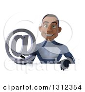Clipart Of A 3d Young Black Male Super Hero Dark Blue Suit Holding An Email Arobase At Symbol Over A Sign Royalty Free Illustration
