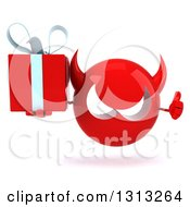 Clipart Of A 3d Red Devil Head Giving A Thumb Up And Holding A Gift Royalty Free Illustration