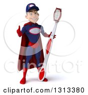 Clipart Of A 3d Young White Male Super Hero Mechanic In Red And Dark Blue Giving A Thumb Up And Holding A Giant Toothbrush Royalty Free Illustration