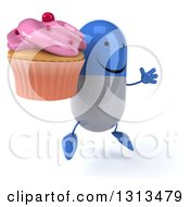 Clipart Of A 3d Happy Blue And White Pill Character Facing Slightly Righ Jumping And Holding A Pink Frosted Cupcake Royalty Free Illustration