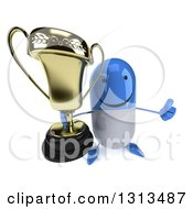 Clipart Of A 3d Happy Blue And White Pill Character Holding Up A Thumb And A Trophy Royalty Free Illustration