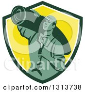 Clipart Of A Retro Male Carpet Layer Carrying A Knee Kicker And Roll Over His Shoulder In A Green White And Yellow Shield Royalty Free Vector Illustration by patrimonio