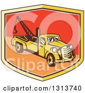 Clipart Of A Retro Tow Truck In A Yellow Red And Orange Shield Royalty Free Vector Illustration