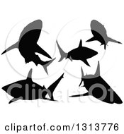 Clipart Of Silhouetted Black Tip Sharks Swimming Royalty Free Vector Illustration