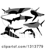 Clipart Of Black Silhouetted Swimming Blue Sharks Royalty Free Vector Illustration