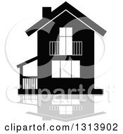 Clipart Of A Black Residential Home And Gray Reflection Royalty Free Vector Illustration