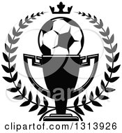Clipart Of A Black And White Soccer Ball In A Championship Trophy Cup Within A Wreath With A Crown Royalty Free Vector Illustration