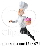 Clipart Of A 3d Young White Male Chef Flying Pointing And Holding A Pink Frosted Cupcake Royalty Free Illustration