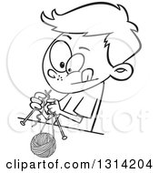 Lineart Clipart Of A Black And White Cartoon Boy Knitting With A Ball Of Yarn And Needles Royalty Free Outline Vector Illustration by toonaday