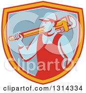 Clipart Of A Retro Male Plumber Holding A Giant Monkey Wrench Over His Shoulder In A Red Yellow White And Blue Shield Royalty Free Vector Illustration
