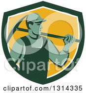 Clipart Of A Retro Male Coal Miner Holding A Pickaxe In A Green White And Yellow Shield Royalty Free Vector Illustration