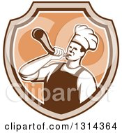 Clipart Of A Retro Male Chef Blowing A Horn In A Brown And Tan Shield Royalty Free Vector Illustration