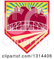 Clipart Of A Retro City Skyline And Bridge In A Shield With Rays Royalty Free Vector Illustration