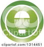 Clipart Of A White LED Light Bulb In A Round Green And White Icon Royalty Free Vector Illustration