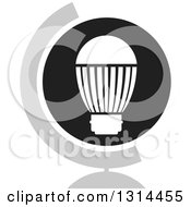 Clipart Of A White LED Light Bulb In A Round Black Icon With A Reflection And Globe Stand Royalty Free Vector Illustration