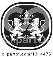 Clipart Of A Black And White Rampant Male Lion And Crown Icon Royalty Free Vector Illustration