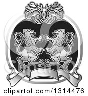 Clipart Of A Silver Black And White Rampant Male Lion Floral And Blank Banner Crest Royalty Free Vector Illustration