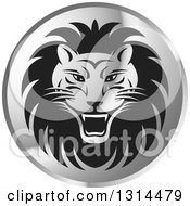 Clipart Of A Gradient Silver Shiny Roaring Male Lion Head Round Icon Royalty Free Vector Illustration