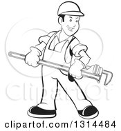 Clipart Of A Cartoon Happy Black And White Male Plumber In Overalls Holding A Giant Monkey Wrench Royalty Free Vector Illustration by Lal Perera