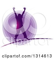 Silhouetted Cheering Man Over A Purple Circle