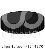 Clipart Of A Cartoon Grayscale Hockey Puck Royalty Free Vector Illustration