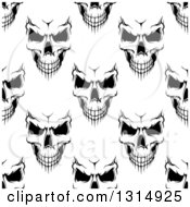 Clipart Of A Seamless Background Pattern Of Black And White Evil Human Skulls Royalty Free Vector Illustration