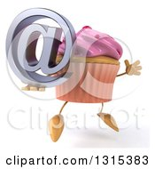 Clipart Of A 3d Pink Frosted Cupcake Character Facing Slightly Right Jumping And Holding An Email Arobase At Symbol Royalty Free Illustration