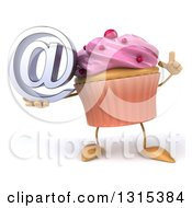 Clipart Of A 3d Pink Frosted Cupcake Character Holding Up A Finger And An Email Arobase At Symbol Royalty Free Illustration