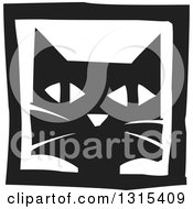 Clipart Of A Black And White Woodcut Cat Face In A Frame Royalty Free Vector Illustration