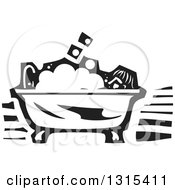 Clipart Of A Black And White Woodcut Person Taking A Bubble Bath In A Claw Foot Tub Royalty Free Vector Illustration