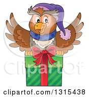 Clipart Of A Cartoon Festive Christmas Owl Flying With A Gift Royalty Free Vector Illustration by visekart