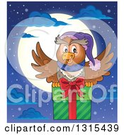 Clipart Of A Cartoon Festive Christmas Owl Flying With A Gift Against A Full Moon Royalty Free Vector Illustration