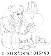Clipart Of A Cartoon Black And White Granny Sitting In A Chair And Reading A Book With A Kitten And Yarn At Her Feet Royalty Free Vector Illustration