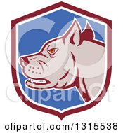 Clipart Of A Cartoon Growling Pitbull Guard Dog In A Maroon White And Blue Shield Royalty Free Vector Illustration