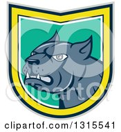 Clipart Of A Cartoon Angry Pitbull Guard Dog Snarling In A Gray Black Yellow White And Turquoise Shield Royalty Free Vector Illustration