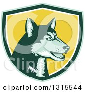 Clipart Of A Retro Woodcut Siberian Husky Dog In A Green White And Yellow Shield Royalty Free Vector Illustration by patrimonio