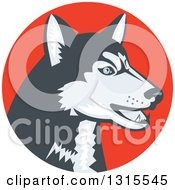 Clipart Of A Retro Woodcut Siberian Husky Dog In An Orange Red Circle Royalty Free Vector Illustration by patrimonio