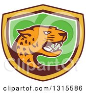 Clipart Of A Retro Cartoon Angry Jaguar Cat In A Brown Yellow White And Green Shield Royalty Free Vector Illustration