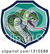 Clipart Of A Cartoon Attacking Cobra Snake In A Blue White And Turquoise Shield Royalty Free Vector Illustration