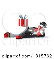Clipart Of A 3d White And Black Clown Resting On His Side And Holding A Gift Royalty Free Illustration