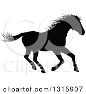 Clipart Of A Black Silhouetted Horse Running 2 Royalty Free Vector Illustration by AtStockIllustration