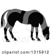 Clipart Of A Black Silhouetted Horse Grazing Royalty Free Vector Illustration