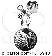 Clipart Of A Black And White Woodcut Male Chef Holding A Moon On A Platter And Standing On Earth Royalty Free Vector Illustration