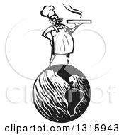 Clipart Of A Black And White Woodcut Male Chef Holding A Hot Pizza Box And Standing On Planet Earth Royalty Free Vector Illustration